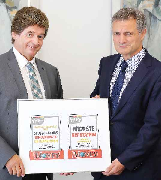 Albert Wasmeier and Gerhard Schenk, managing directors of RAFI accept the FOCUS MONEY awards